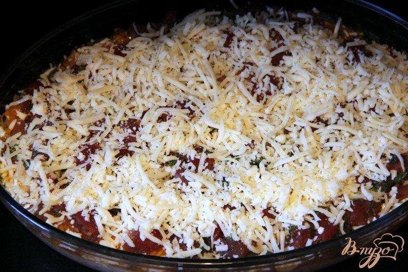 Фото приготовление рецепта: Рыбно-рисовая запеканка  под тыквенно-томатным соусом шаг №9