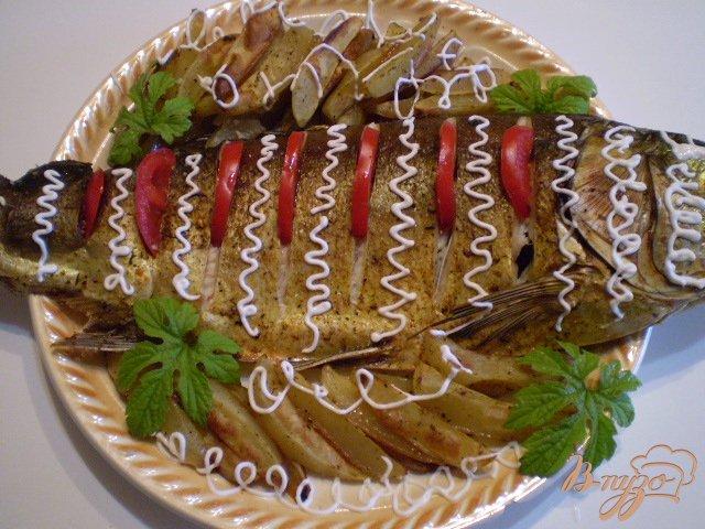 Фото приготовление рецепта: Рыба с овощами в духовке шаг №4