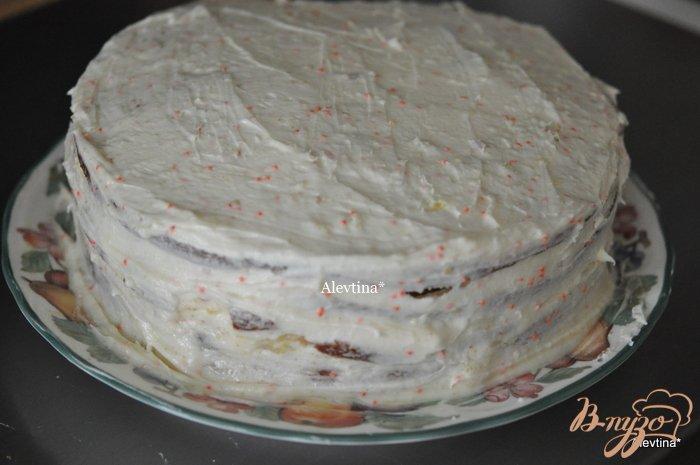Фото приготовление рецепта: Апельсиновый кекс с начинкой и цитрусовыми цукатами шаг №8