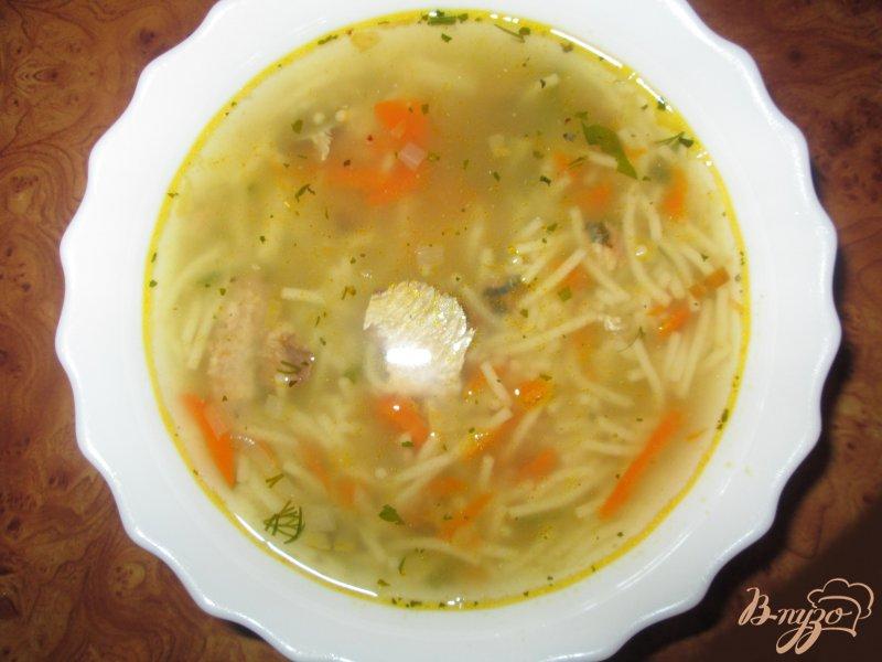 Фото приготовление рецепта: Рыбный суп из сардин шаг №8