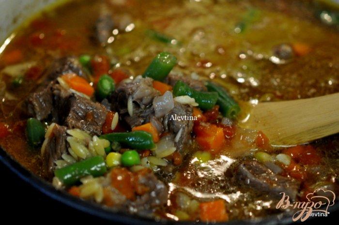 Фото приготовление рецепта: Говяжий суп шаг №4