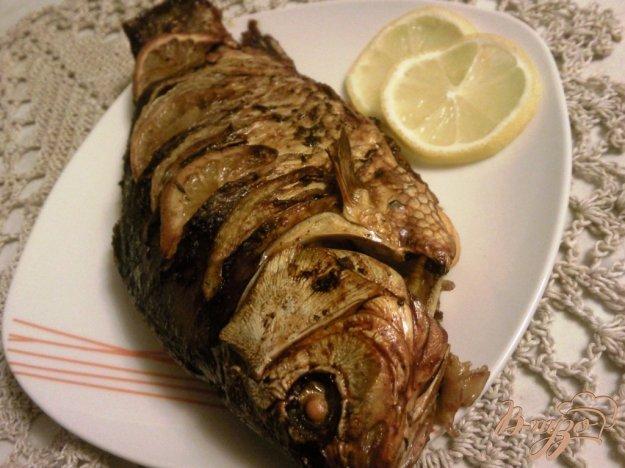 Рецепт Караси с лимоном и луком