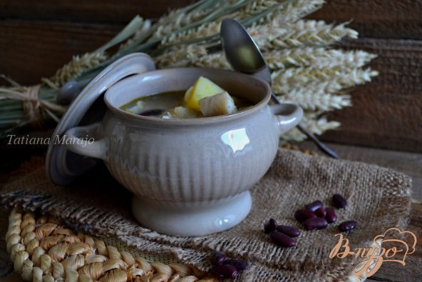 Фото приготовление рецепта: Густой суп с рыбой, крупами и фасолью шаг №5