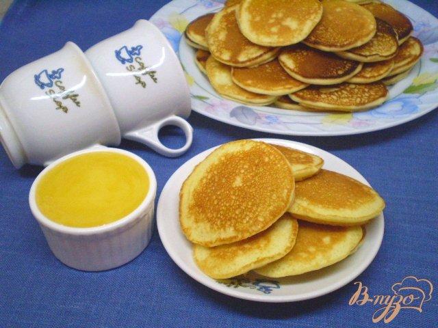 Фото приготовление рецепта: Оладьи молочные с лимоном шаг №9