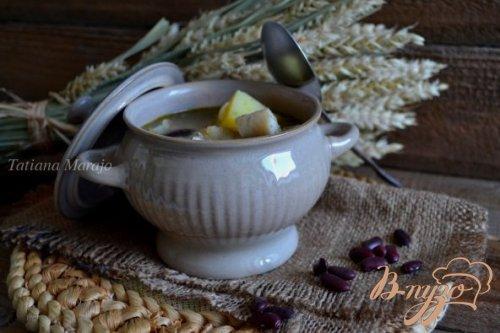 Густой суп с рыбой, крупами и фасолью