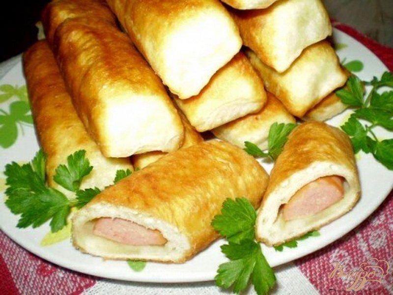 Фото приготовление рецепта: Сосиски в тесте шаг №7
