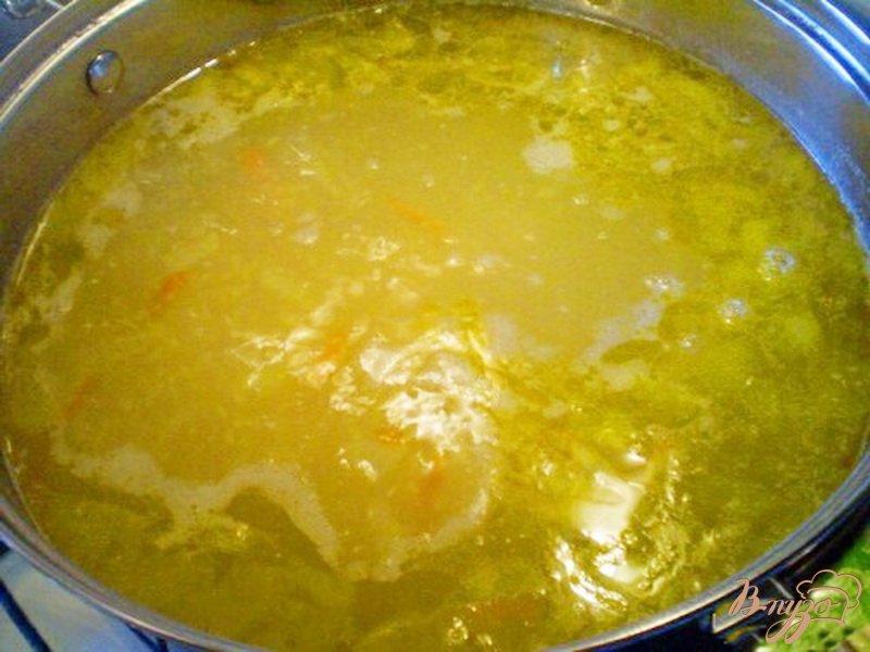 Фото приготовление рецепта: Суп картофельный с кукурузной крупой шаг №4