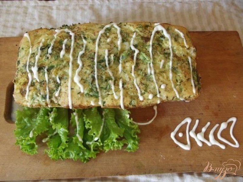 Фото приготовление рецепта: Слоеный пирог с рыбой шаг №8