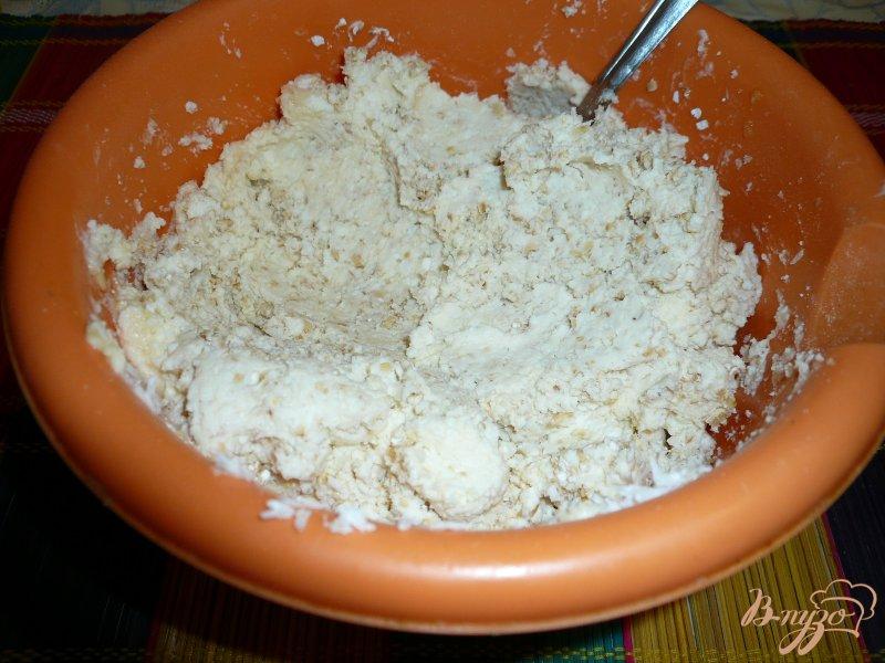 Фото приготовление рецепта: Запеканка творожная с кокосовой стружкой и отрубями шаг №6