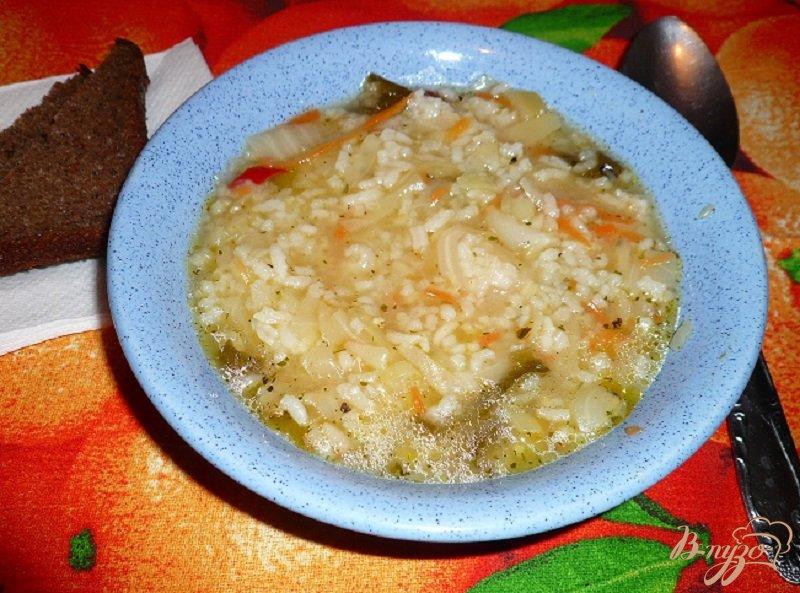 Фото приготовление рецепта: Суп с капустой и рисом шаг №9