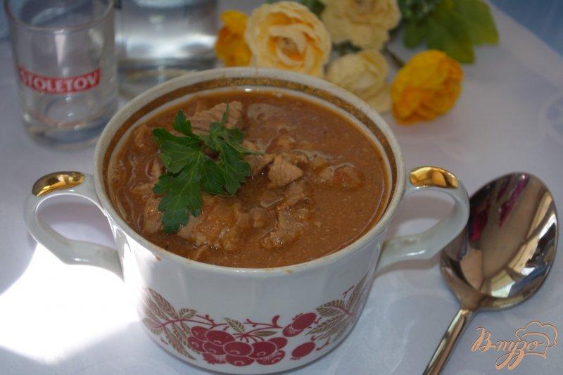 Фото приготовление рецепта: Мясо тушеное в томате с фасолью шаг №8
