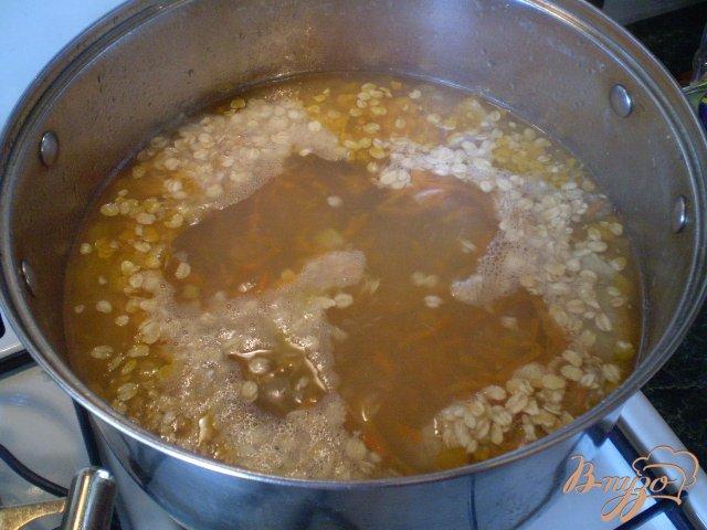 Фото приготовление рецепта: Овсяный суп на курином бульоне шаг №4