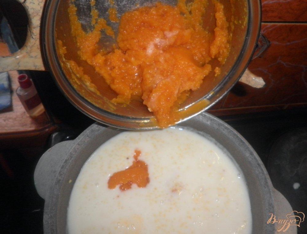 Фото приготовление рецепта: Тыквенная каша с пшеном и с изюмом шаг №6