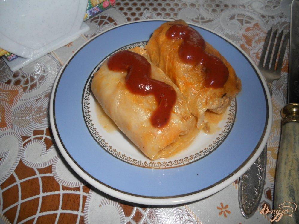 Фото приготовление рецепта: Голубцы в томатно-сметанном соусе шаг №15