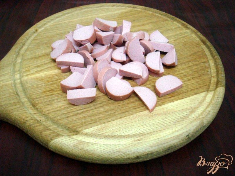 Фото приготовление рецепта: Овощной суп с кабачками и сардельками шаг №7