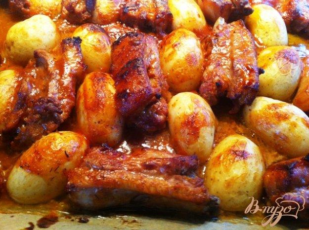 Свинячі ребра в кисло-солодкому маринаді з картоплею. Як приготувати з фото