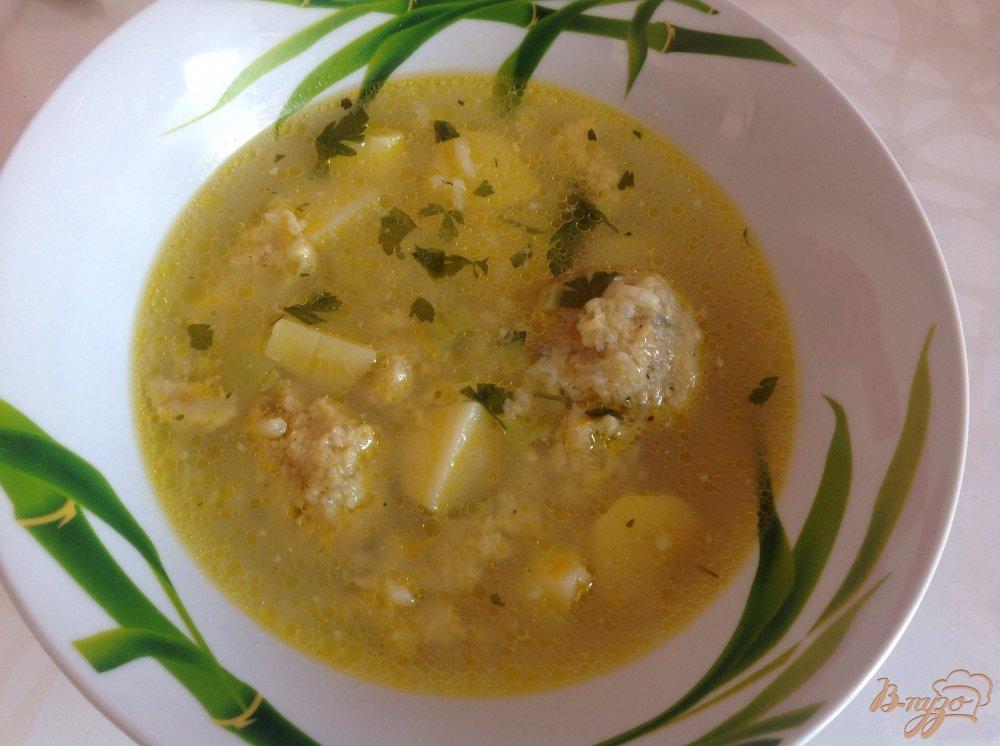 Фото приготовление рецепта: Суп с рыбными фрикадельками шаг №9