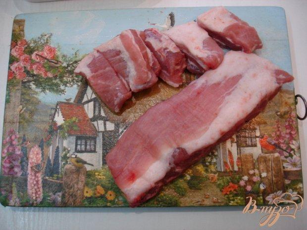 Свиные рёбрышки запеченные с чесноком