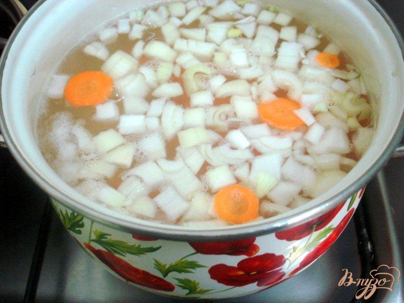 Фото приготовление рецепта: Суп из карасей шаг №6