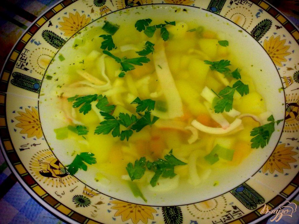 Фото приготовление рецепта: Суп с кальмаром шаг №6