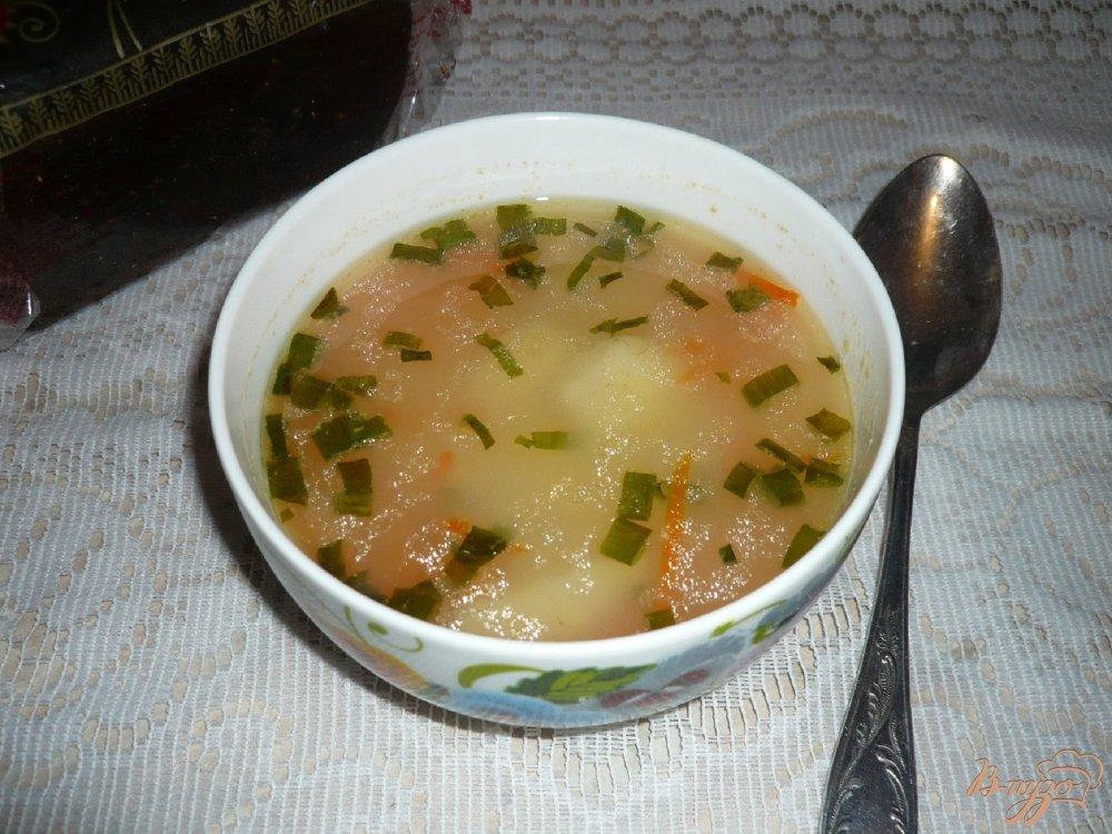 Фото приготовление рецепта: Суп с рисом и картофелем шаг №6
