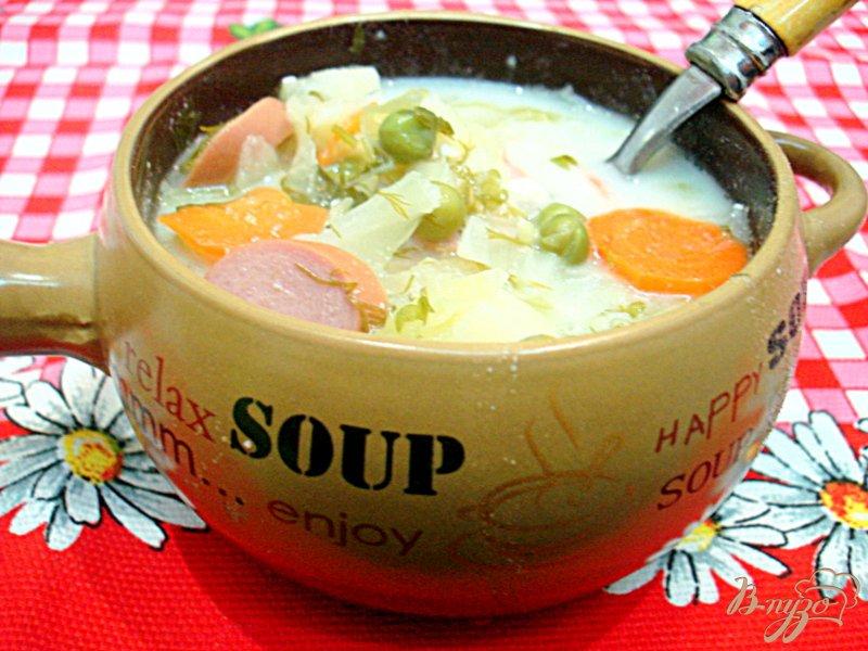 Фото приготовление рецепта: Суп с сырками и зелёным горошком шаг №10