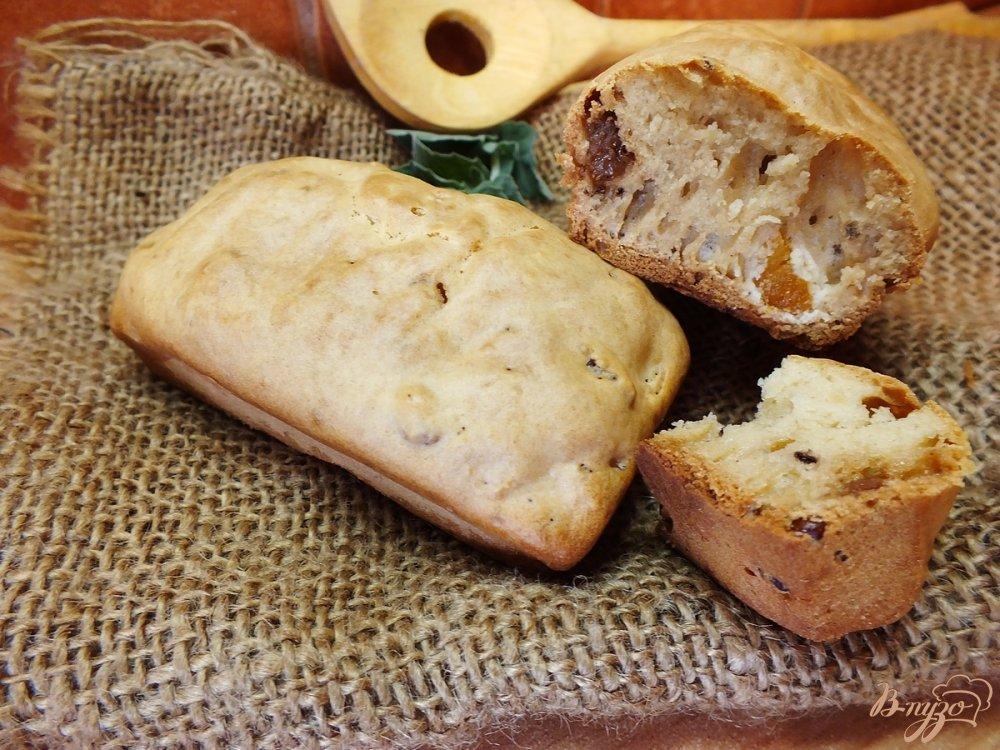 Фото приготовление рецепта: Не сладкие ореховые булочки с изюмом и курагой шаг №7