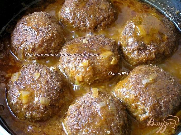 Фото приготовление рецепта: Тефтели в томатном соусе со спагетти шаг №7
