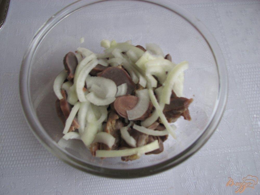 Фото приготовление рецепта: Закуска из куриных сердец и желудочков шаг №8