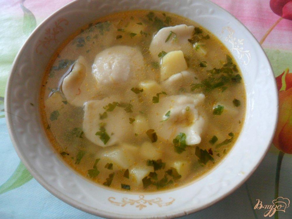 Фото приготовление рецепта: Пельменный суп шаг №7