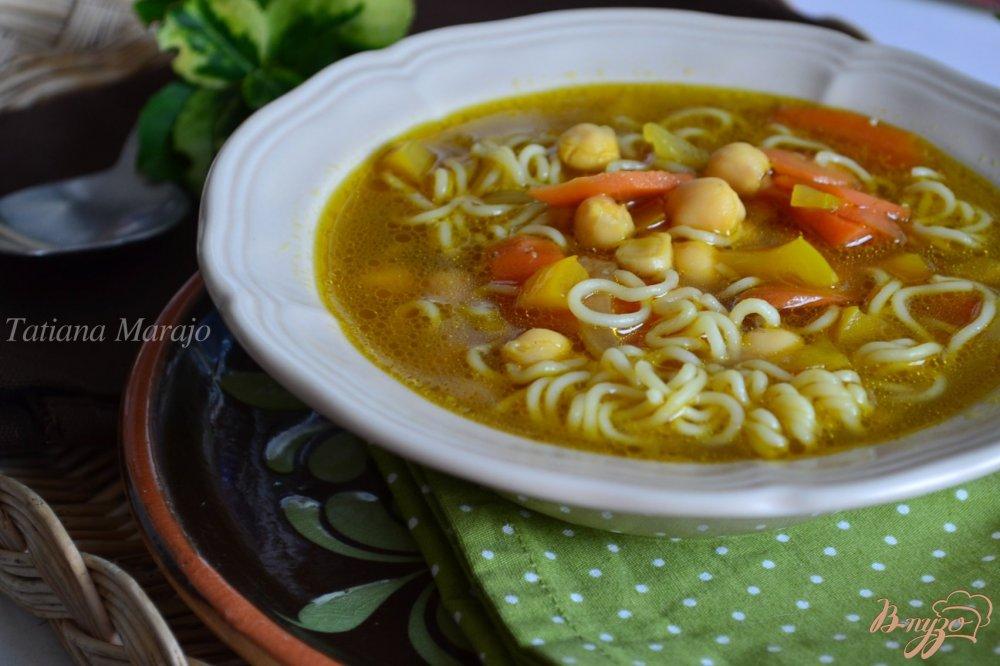 Фото приготовление рецепта: Суп с нутом и лапшой шаг №6
