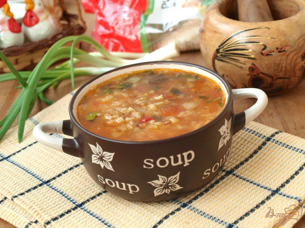 Фото приготовление рецепта: Рисовый суп с чечевицей и томатами шаг №6