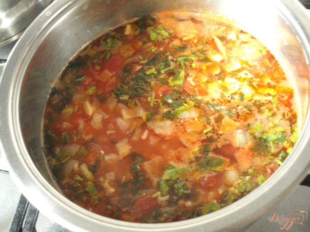 Фото приготовление рецепта: Рисовый суп с чечевицей и томатами шаг №5