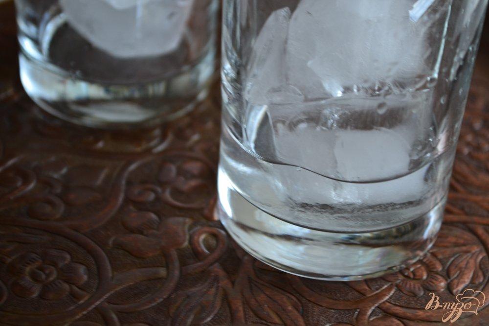 Фото приготовление рецепта: Апельсиново-дынный коктейль с водкой шаг №3