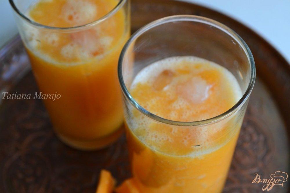 Фото приготовление рецепта: Апельсиново-дынный коктейль с водкой шаг №4