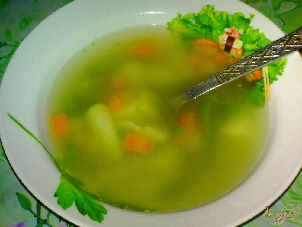 Фото приготовление рецепта: Суп с кальмаром шаг №7