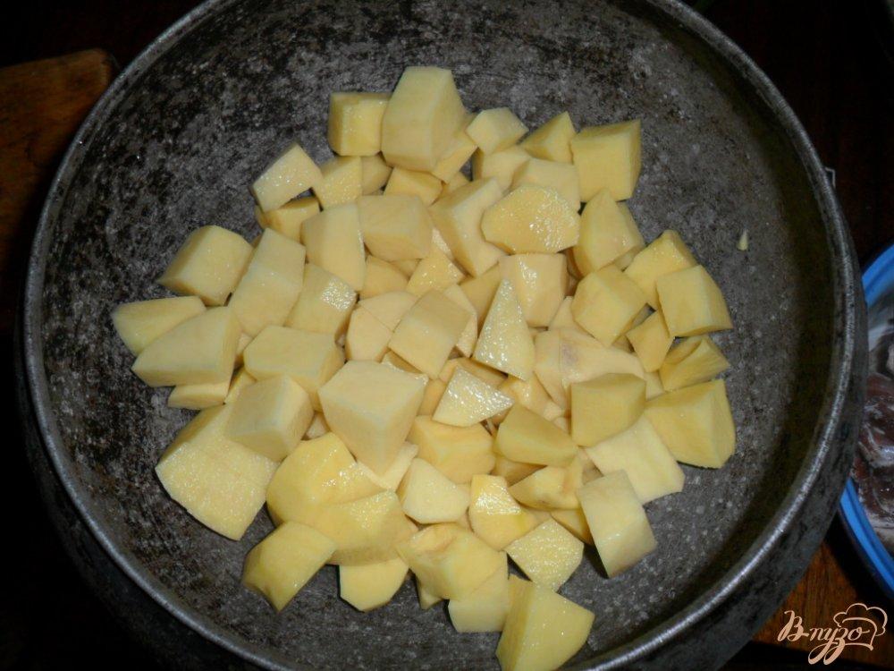 Фото приготовление рецепта: Тушенная картофель с свиными ребрами шаг №2
