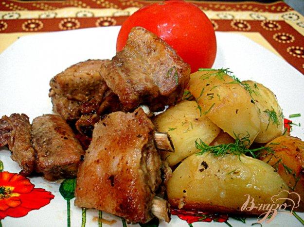 Реберця запечені з картоплею. Як приготувати з фото