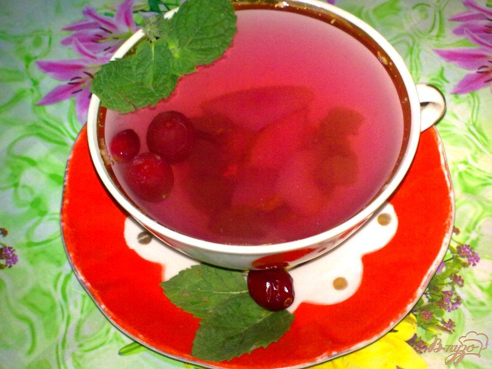 Фото приготовление рецепта: Компот из груш с виноградом и клюквой шаг №5
