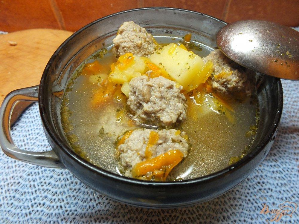 Фото приготовление рецепта: Суп с фрикадельками и тыквой шаг №10