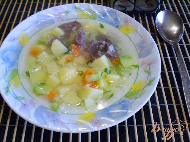 Фото приготовление рецепта: Рисовый суп с кабачком на пупках шаг №6
