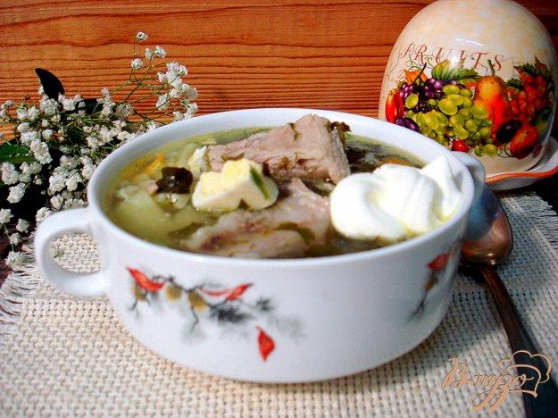 фото рецепта: Щавелевый суп на свиных рёбрышках с рисом