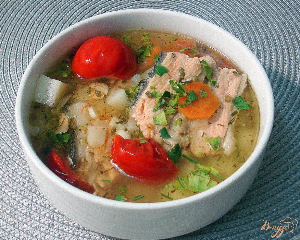 Фото приготовление рецепта: Рыбный суп с томатами шаг №8