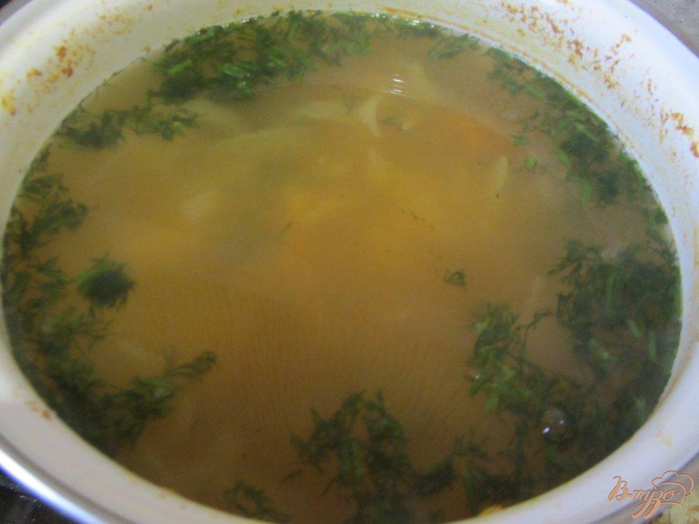 Фото приготовление рецепта: Рыбный суп с рисом шаг №7