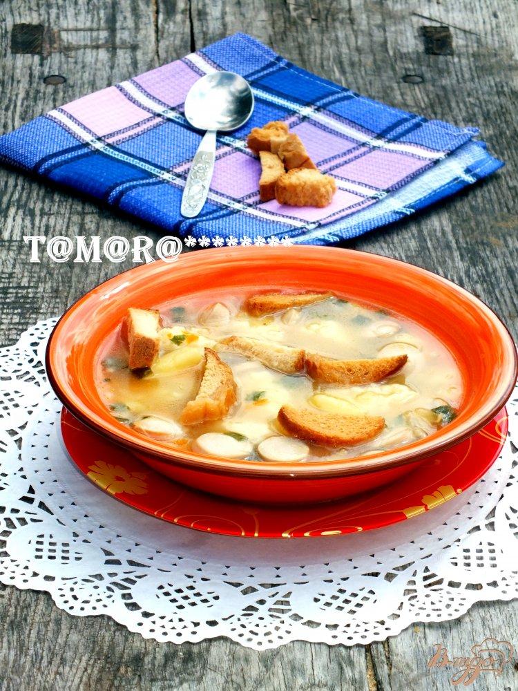 Фото приготовление рецепта: Суп с сосисками и сырными клецками шаг №8