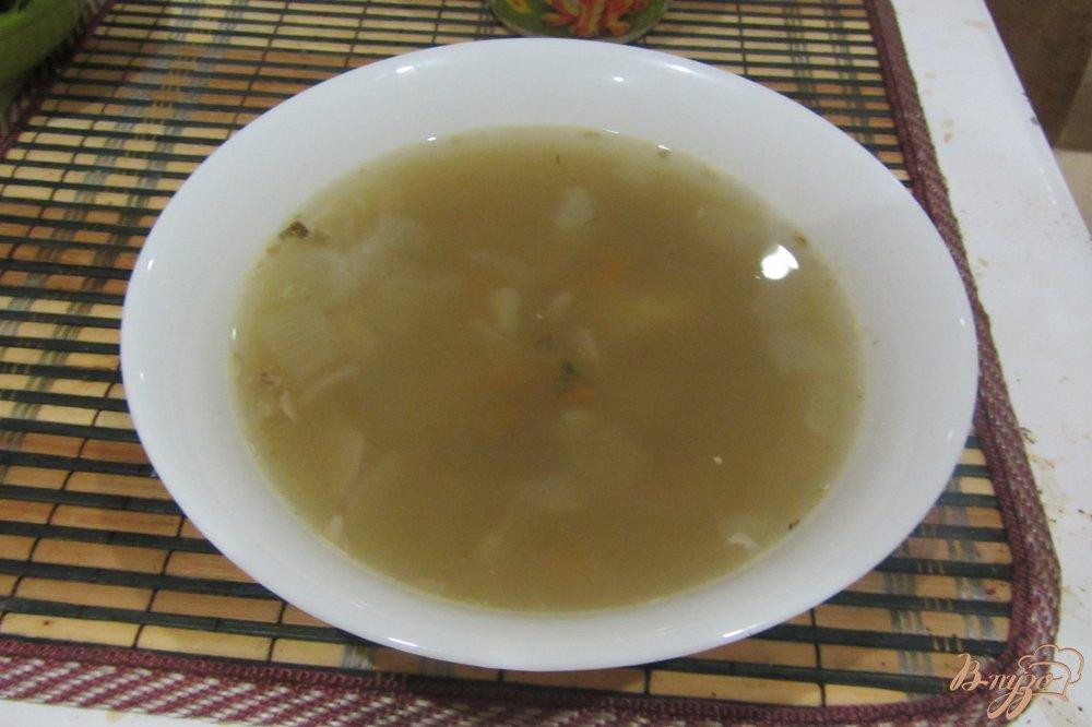 Фото приготовление рецепта: Рыбный суп с манной крупой шаг №8