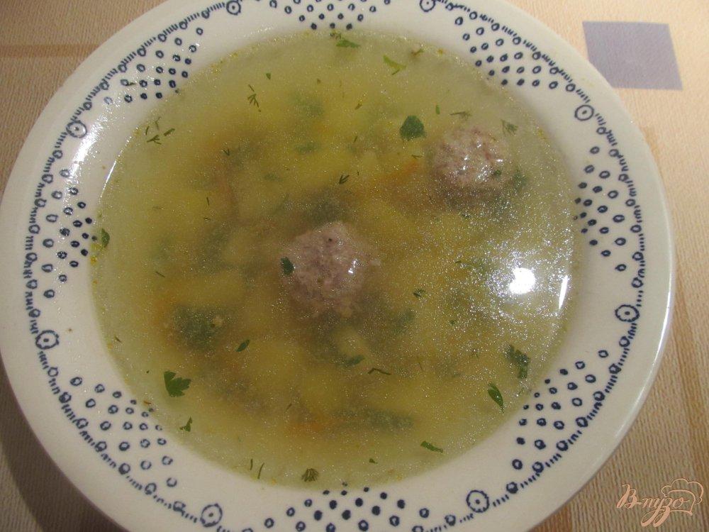 Фото приготовление рецепта: Суп с фрикадельками шаг №7