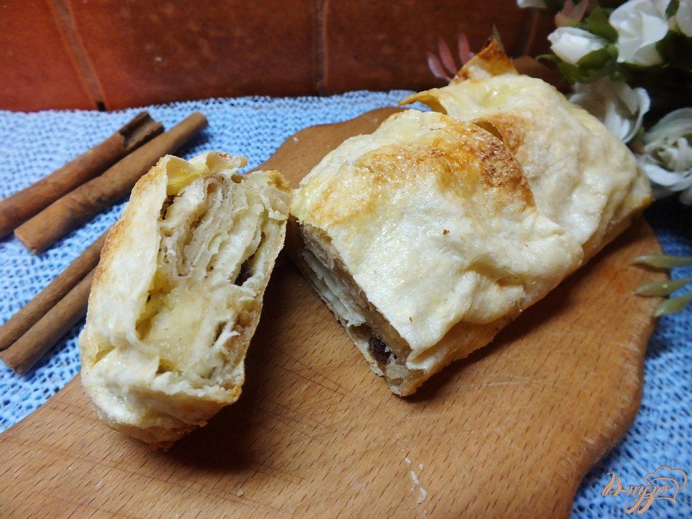 Фото приготовление рецепта: Пирог из лаваша с изюмом крученый шаг №10