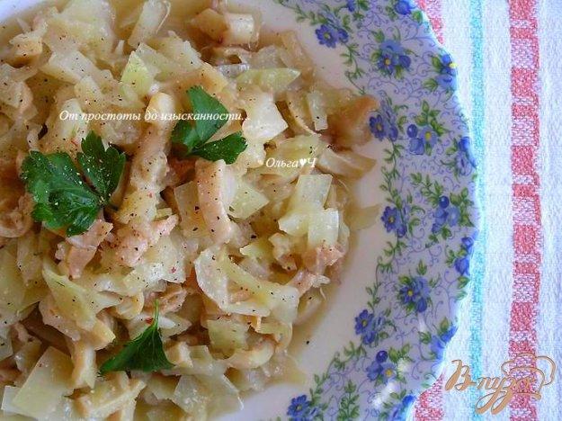 фото рецепта: Кальмары, тушеные с капустой в белом вине