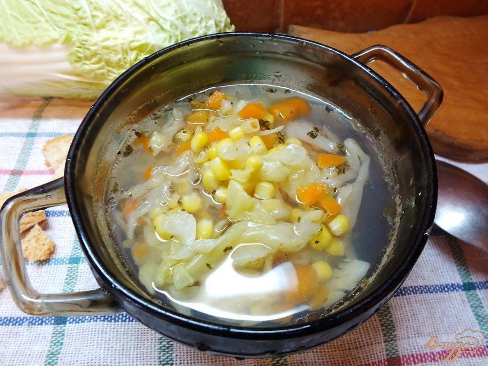 Фото приготовление рецепта: Суп из кукурузы с капустой и морковью шаг №5